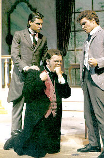 Drama student Freeman Williams begs for mercy while co-actors Michael Farris and Mark Mitchell listen with disgust.