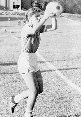 Women's soccer player throwing ball