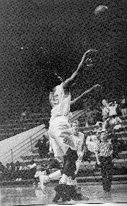 Leslie Hale shooting a basketball.