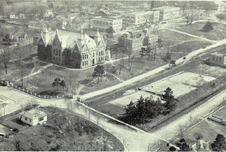 View of campus from the northwest, showing the tennis court and Huntsville's Avenue L as a dirt street.