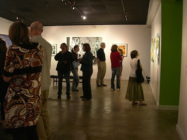 Patrons viewing art at the gallery.