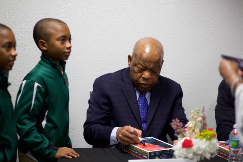 Representative John Lewis signing his book for a Huntsville elementary school student.