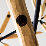 Detail of sculptor James Surl's Arround the Flower Wall, a hanging mobile of several radially arranged carved wooden paddles