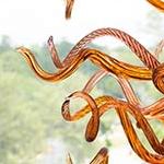 Detail of the bright orange spiraled blown glass artwork by glass artist Jason Lawson