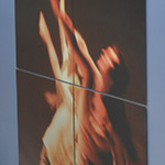 Three large photographs of dancers on the stage, by photographer Rebecca Finley