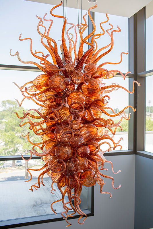 Orange glass blown artwork by Jason Lawson