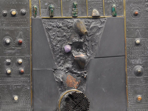 Detail photo of the disc shaped metal and stone assemblage by artist Charles Pebworth