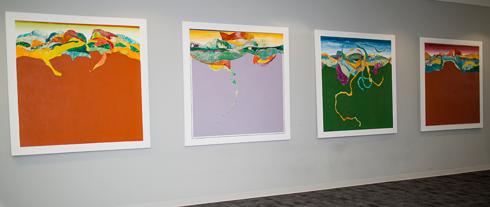 Four large square paintings in bright colors
