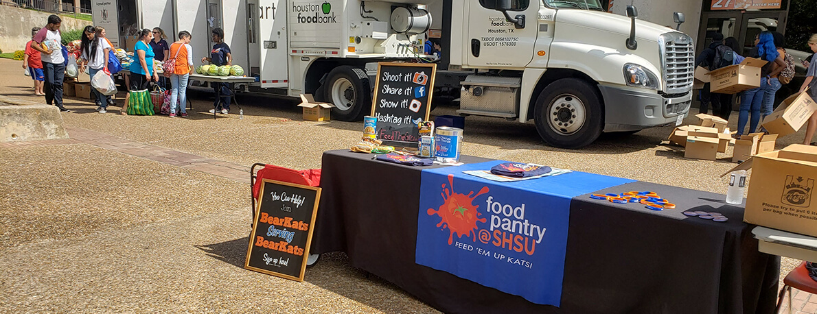 Food Pantry table in front of Houston Food Bank truck