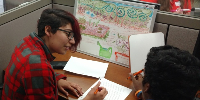 A student helps another student with their writing.
