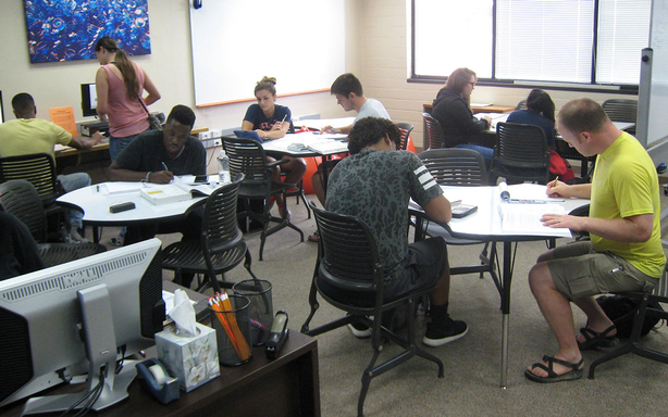 Individuals working in the Math Center