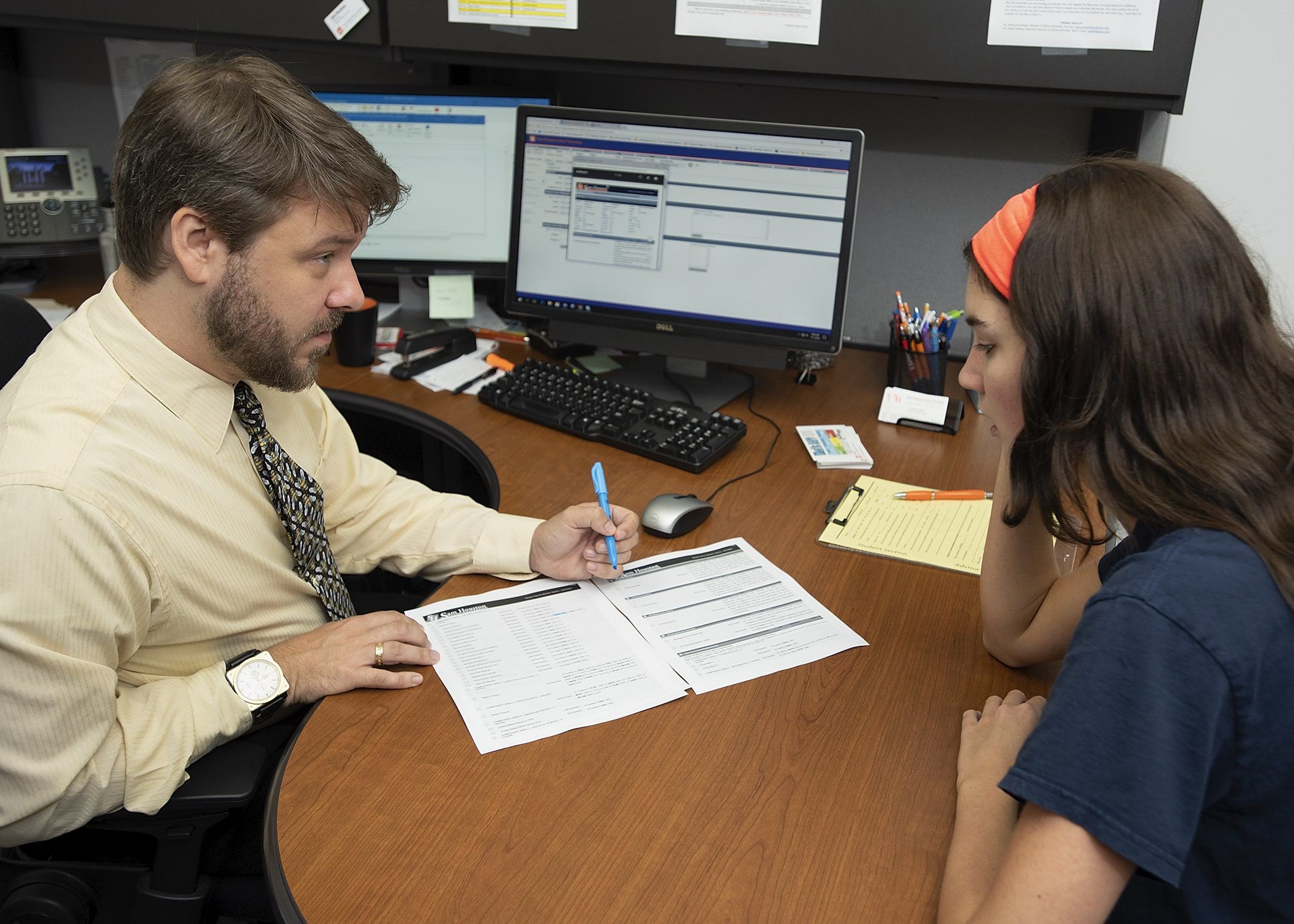 A student being given options for course selections during advising.