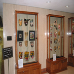 The Breitenbach Mexican Mask Collection, donated by Professor William Breitenbach, displayed by the central staircase on the fourth floor. This is the fourth largest collection of Mexican masks in the world.