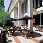 The library's main entrance on the west side faces the interior of campus. The library's front patio features shaded outdoor seating.