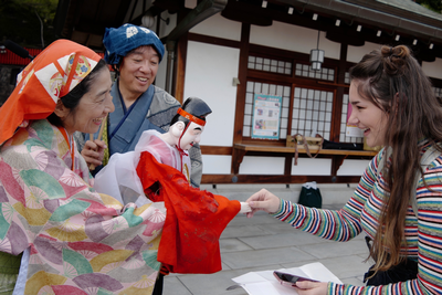 thumbnail view of Faces of Study Abroad - Bree Cloud - Japan - Fall 2019 - Ebisu - Meeting the puppet version of the Japanese god of fishing, Ebisu, with local puppeteers at Mondoyakujin temple