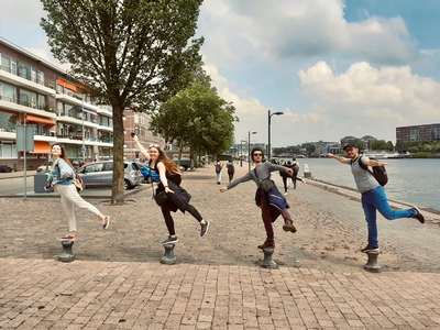 thumbnail view of Faces of Study Abroad - Amanda Grace Stine - Netherlands Spring 2020 - Balancing Act - It took many photos to get one where we were all balancing and not falling off the posts