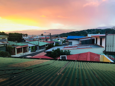 thumbnail view of Natural Beauty - Joana Vaca - Costa Rica - Summer 2019 - Sunset - Here you can observe the sunset from what we know as Casa Conversa. This is a view you have from our meet up place