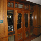 Ornate walnut-paneled doors lead to the Thomason Room, home of the library's Special Collections, housing rare, valuable, and fragile materials as well as collections on topics like criminal justice and Samuel Clemens.