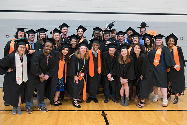 Group of students posing in graduation gowns