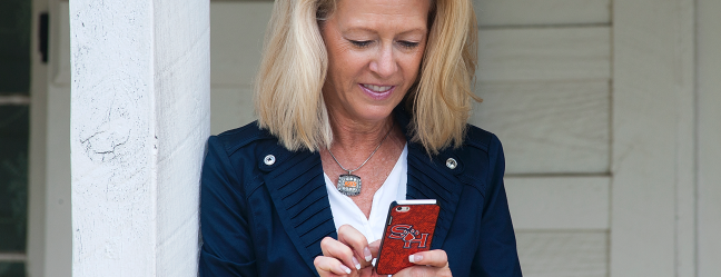 President Dana G. Hoyt Using user her phone to access social media