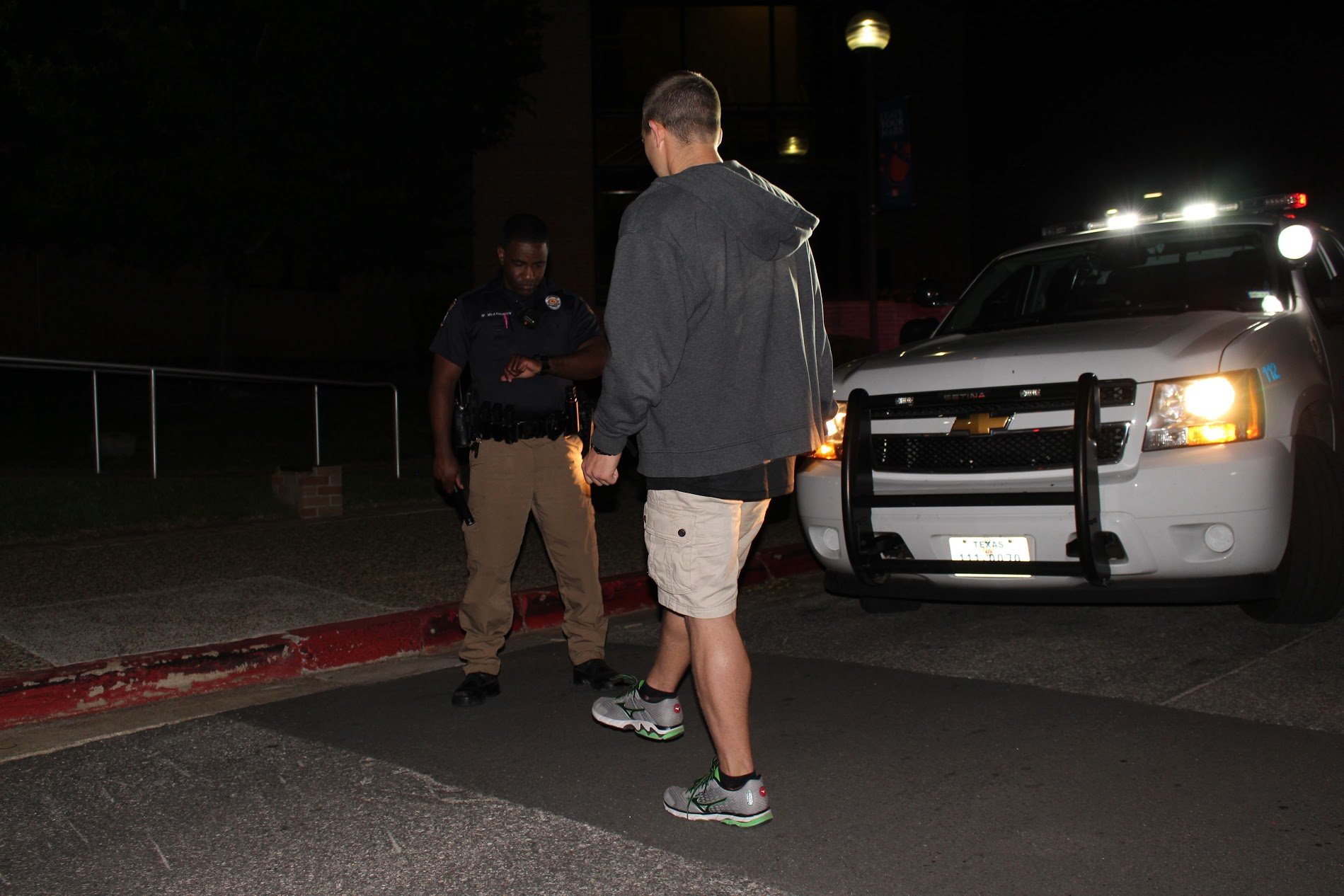 Officer conducts DWI test at night