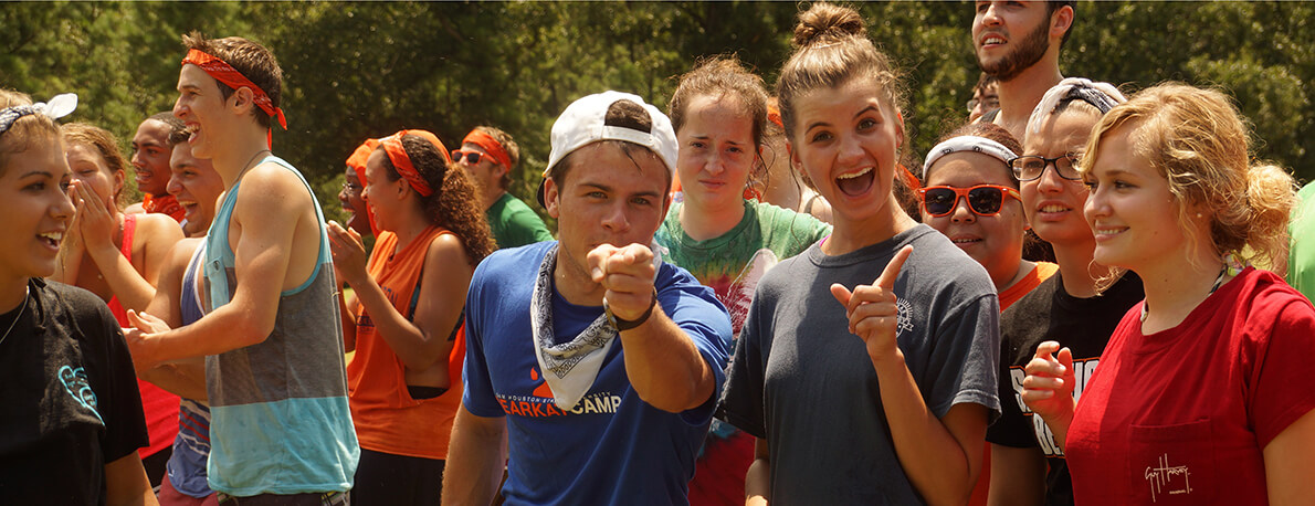 Campers pointing towards the camera