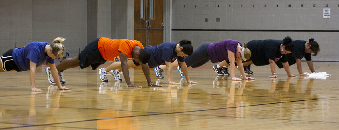 fitness class in plank position