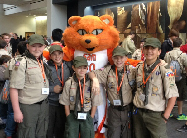 Sammy Bearkat posing with Scouts in the Gaertner Performing Arts Center