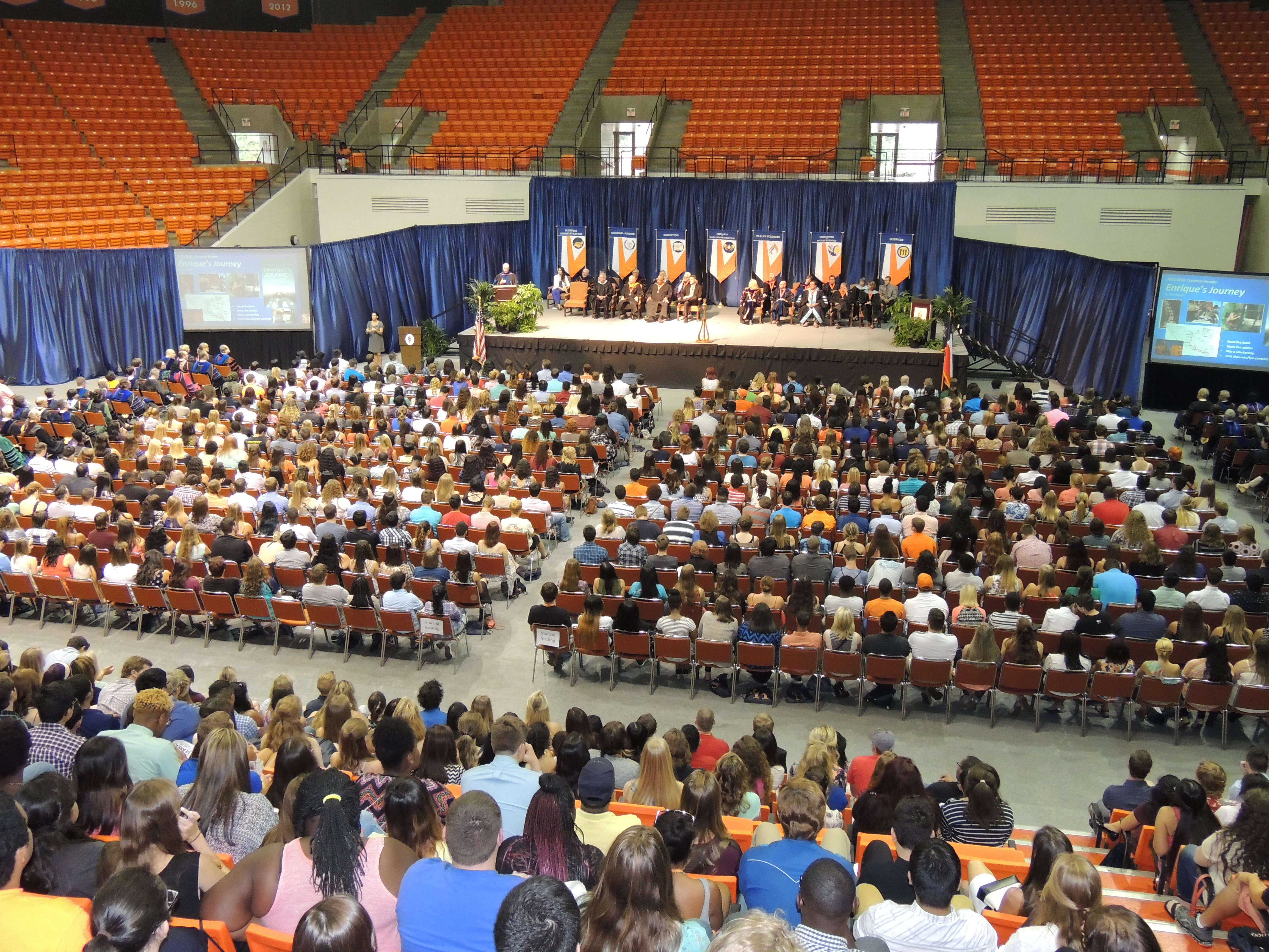 A large number of students gather in the Johnson Coliseum for New Student Convocation.