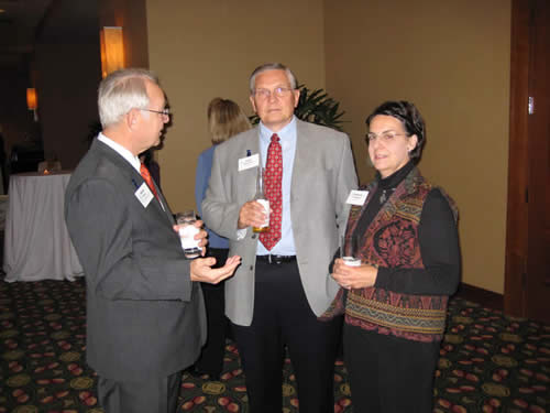 Dr. David Payne visits with John and Frances Planchard