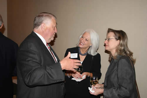 Charles Rushing visits with Dean Brown and Elizabeth Norwood