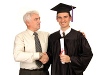 Man shaking hands with a graduate