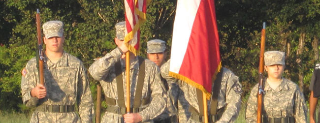 Soldiers in Uniform with Flags and Guns