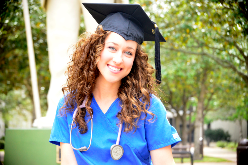 Nurse wearing a graduation hat with a stethoscope on her neck