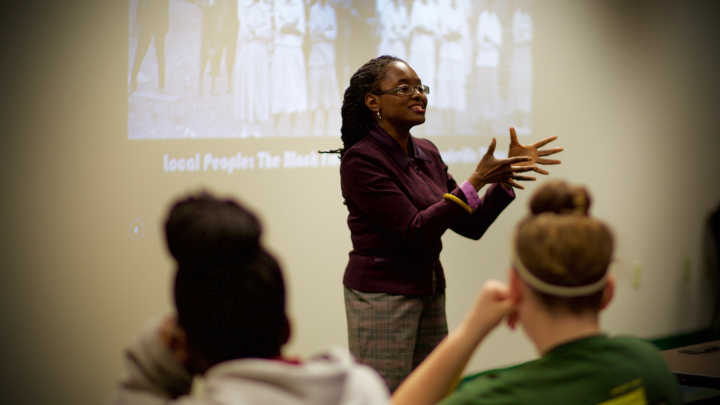 Dr. Bernadette Pruitt, associate professor of history at SHSH, teaches a lesson on civil rights in the local Huntsville community to 7th graders at Mance Park Middle School during the Believe In Possibilities: 7th Grade Initiative