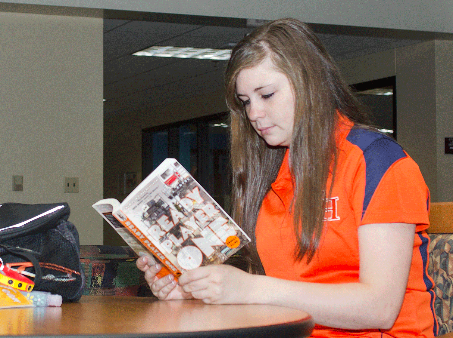 Students reading Ready Player one