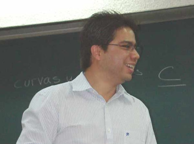 Dr. Luis David Garcia Puente standing in front of a chalkboard.