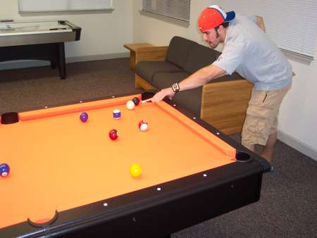 Student playing billiards