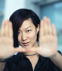 Asian woman framing a photo with her hands