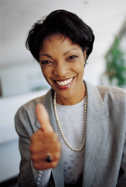 African American woman giving a thumbs up