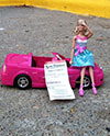 Barbie doll with parking ticket
