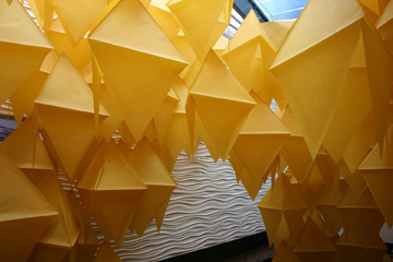 Close up of geometric hanging paper objects