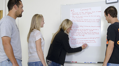 Students working at a whiteboard.