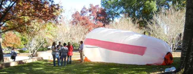students standing in front of inflatable project