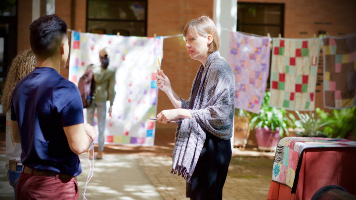 Quilts created by Professor Catherine Blumenkamp's FACS 1330 ACE class are displayed during a showing on the SHSU campus. These quilts were designed to improve the lives of young children who access Huntsville Head Start for early childhood education