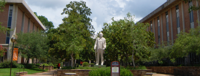 sam statue on campus in mall area