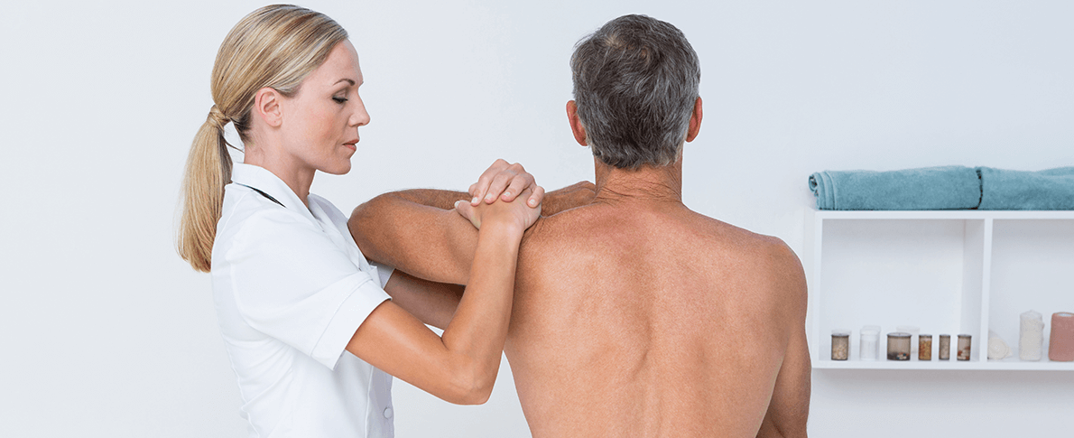 Therapist working on a patient's back