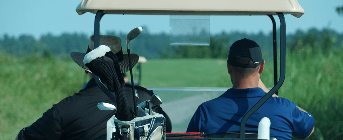 Man in Golf Cart with Clubs