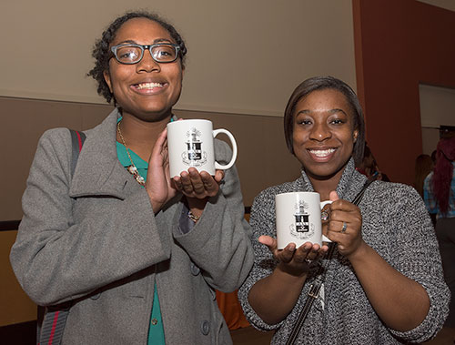 Dawine and another student with ALD mugs
