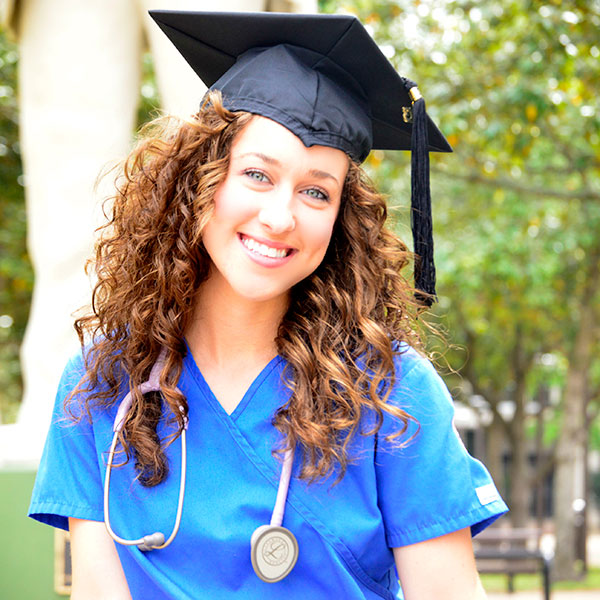 nursing student with graduation hat on